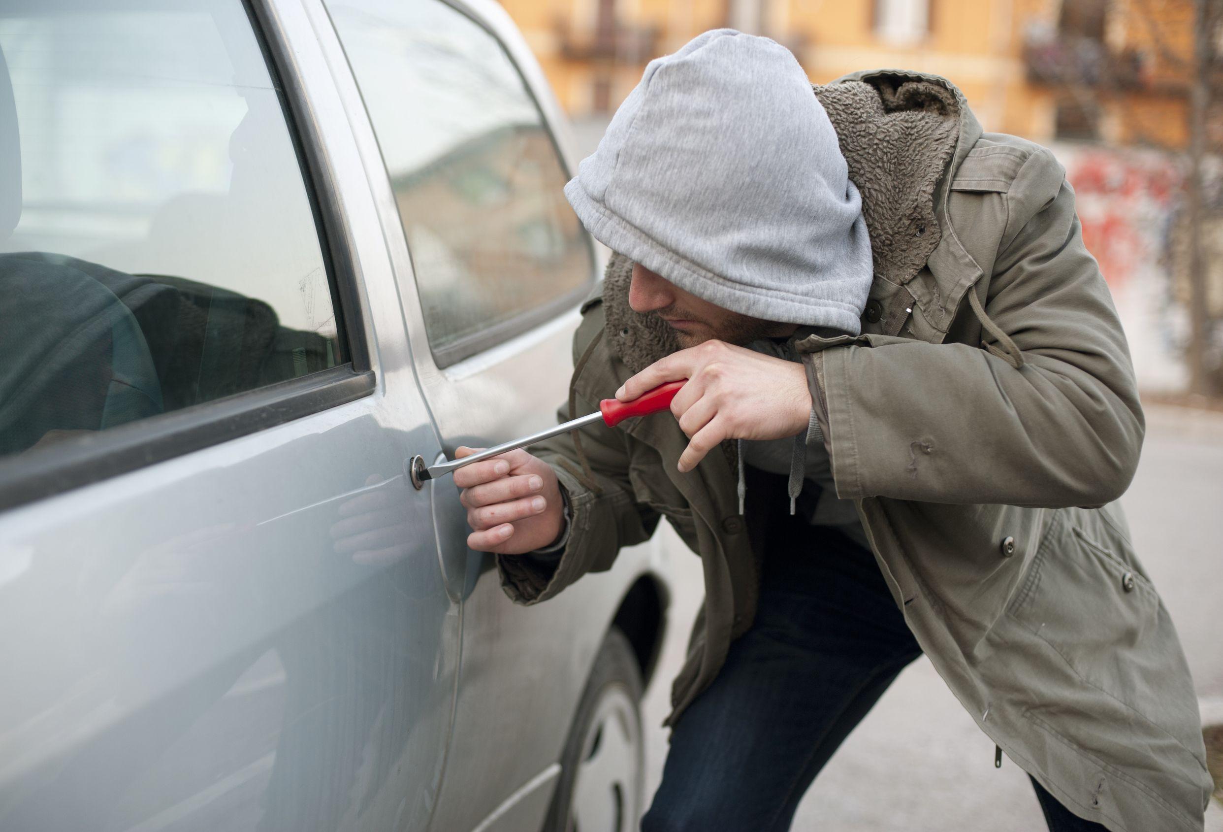 12598477 - car thief in action